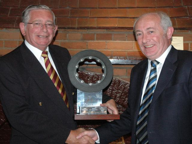 Paul Richmond presents the Trophy (a brake Disc from Montoya's car) to Graham McGregor - Graham had come down from Scotland just for this match!