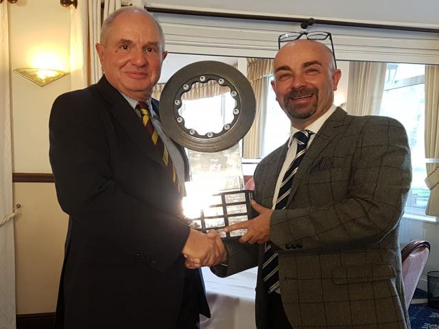 Kevin Davidson Director BMW presenting the Trophy to Roger Prowting (standing in for Martin)
