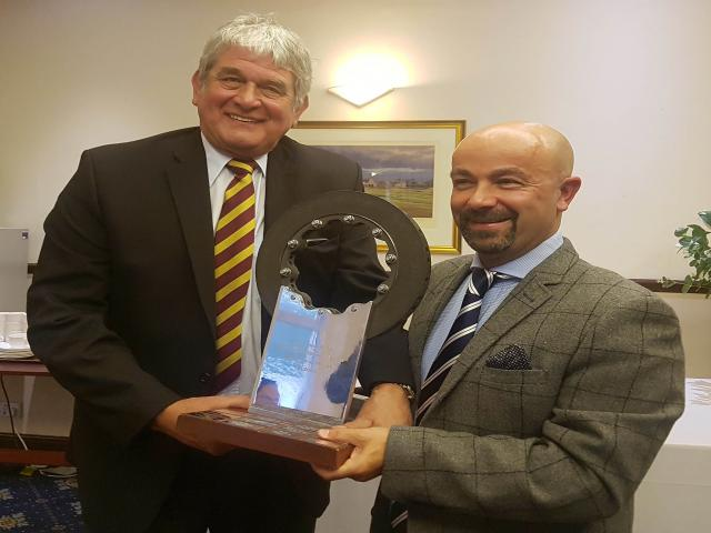 Paul Williams, President, presenting (well returning!) the Trophy to Kevin Davidson Director BMW
