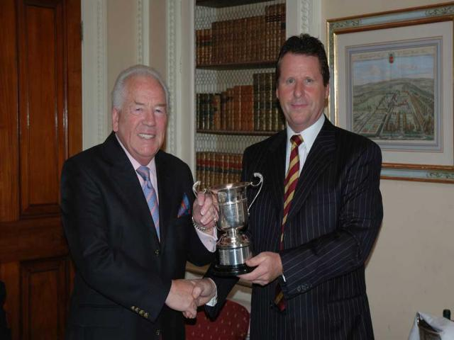 Peter Featherstone presenting the Trophy back to Fredie Aldous