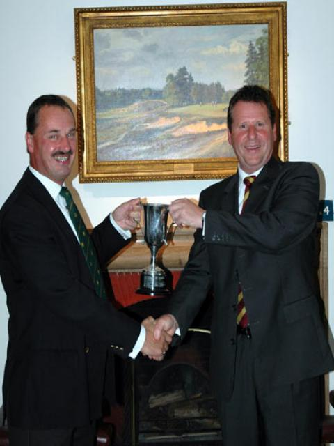"""Peter presenting """"cup"""" to Bill"""