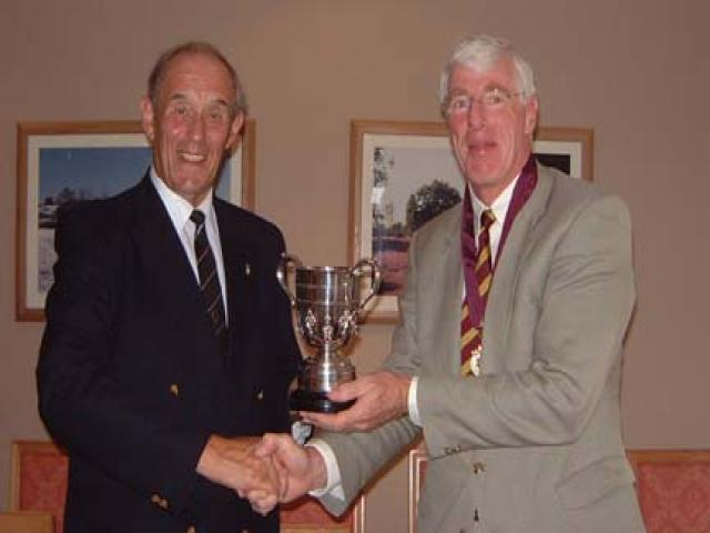 Nick Kingsbury presenting Cup to Peter Baker. (r to l)