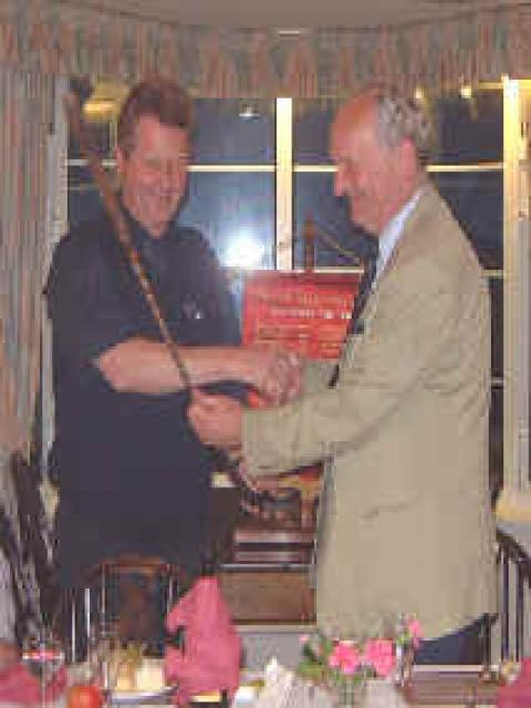 Peter Featherstone presenting John Stambrook with the famous Putter! - (we failed to retain it!)
